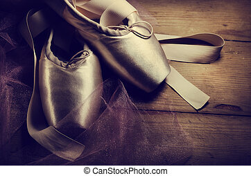 Pointe Shoes - Pointe shoes on wooden background