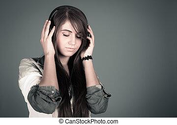 Young woman enjoying the music - Young beautiful woman...