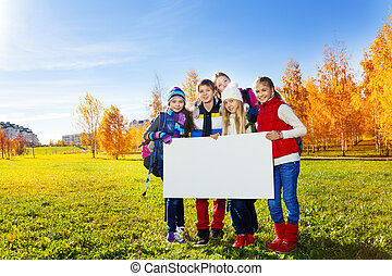 Many kids hold white board - Group of happy teen kids...