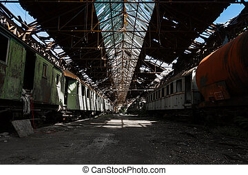 train wreck in an abandoned warehouse