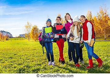 Happy school kids in park