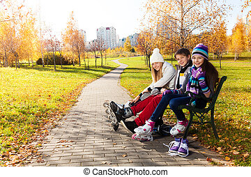 Three kids getting ready to skate - Two girls and a boy...