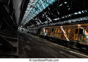 train wreck in an abandoned warehouse - old train wreck in...