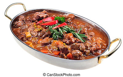 Lamb stew garnished with fresh rosemary in oval stainless...