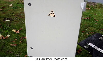 High voltage sign on the cabinet that indicates that when...