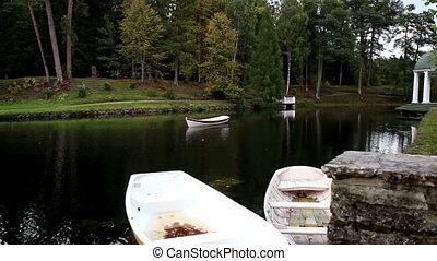 Three row boats floating