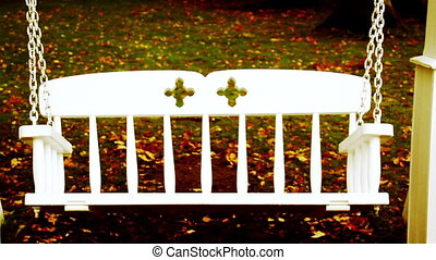 Bench swing swinging and fallen leaves halloween - Bench...