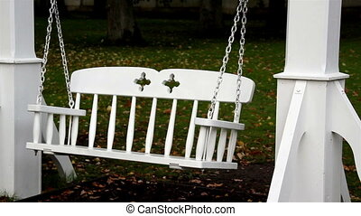 Bench swing and tree branch found at the back of the...