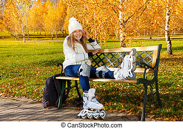 Autumn roller-skating - Happy laughing blond teen girl with...