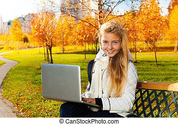 Autumn good time to do homework outside - Close portrait of...