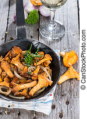 Fried Chanterelles in a skillet - Fried Chanterelles with...
