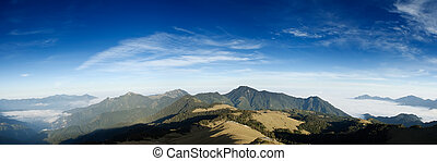 Beautiful panorama mountain landscape with blue sky.