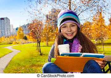 School girl with coffee and textbook