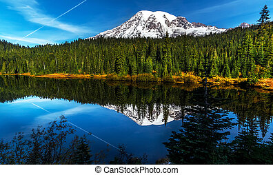 Reflection lake, Mt. Rainier. - Reflection of an aircraft...