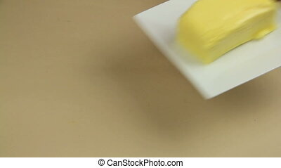 Making Vanilla Cookies 1 - Adding softened butter to a...
