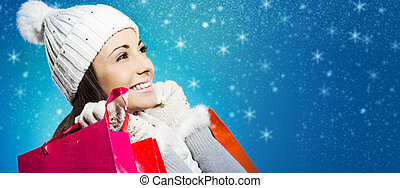 Woman with shopping bags - Beautiful young woman with her...