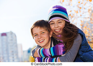 Hugging couple kids - Boy and girl hugging and smiling 10...