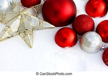 Christmas Decorations Framing Snow Background - Red and...