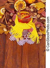 Glass of mulled wine in yellow scarf - Glass of mulled wine...