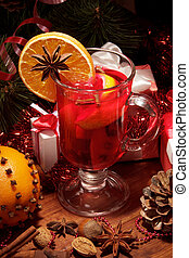 Glass of mulled wine with orange - Close up glass of mulled...