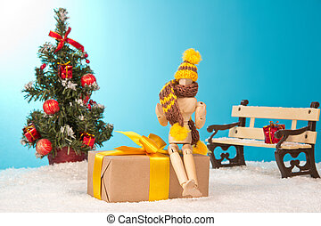 Happy man sitting on the gift