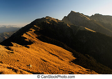 The sunrise golden beautiful high mountain landscape.