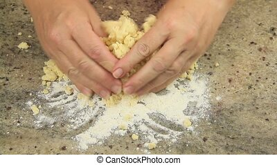 Making Vanilla Cookies 4 - Rolling biscuit mixture into a...