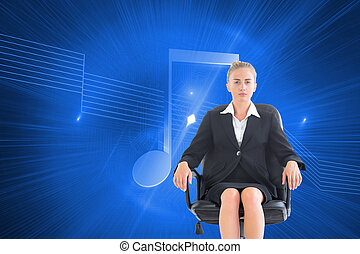 Composite image of blonde businesswoman sitting on swivel...