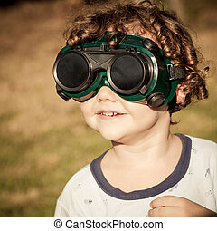Boy in the welding goggles