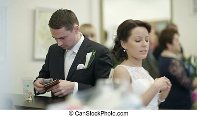 Bride and groom in register office. - Bride and groom in...