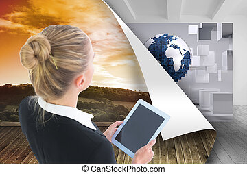 Composite image of businesswoman holding tablet - Composite...