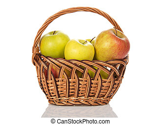 Wattled basket with the apples, isolated on white