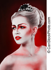 Attractive girl with theatrical make-up - Portrait of...