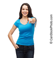 happy girl in blank blue t-shirt pointing at you