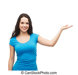teenager holding something on the palm of her hand