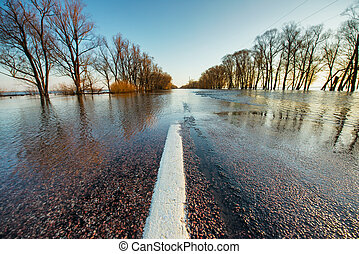 Flooded rural road in spring - Rural road covered by hight...