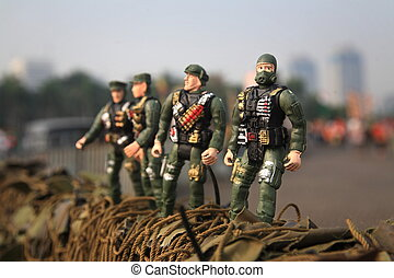 toy soldier at army vehicle