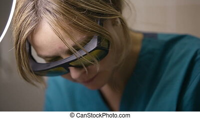Doctor doing a fractional skin laser treatment - Panning...