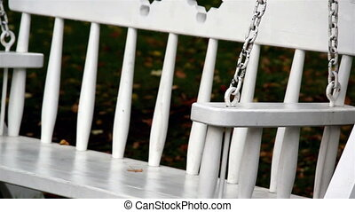 Up-close image of the bench swing its seat and also the...