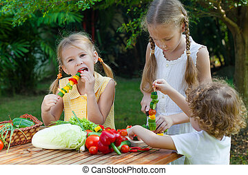children playing with vegetables