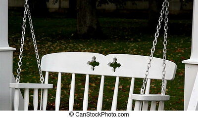 Chain safely attached to the bench swing and pillar to make...