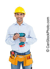 Smiling handsome young handyman in - Portrait of a smiling...