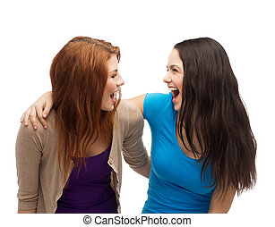 two laughing girls looking at each other