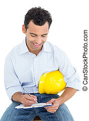 Handyman with yellow hard hat writing in clipboard - Smiling...