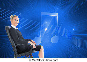 Composite image of businesswoman sitting in swivel chair -...