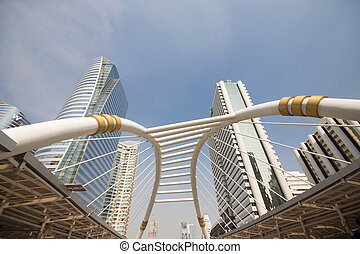 Pubic skywalk with modern buildings of Bangkok