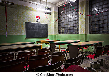 old desolate classroom in an industrial firm - desolate...