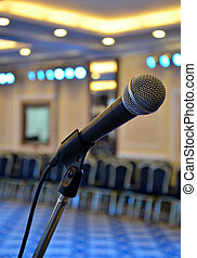Microphone at the front close-up in the hall richly - The...
