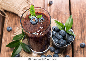 Blueberry Juice - Blueberry juice with fresh fruits on wood
