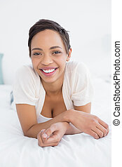 Smiling pretty young woman relaxing in bed - Portrait of a...